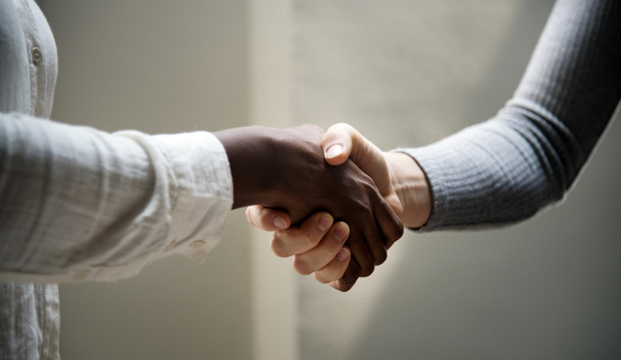 shaking hands business contract